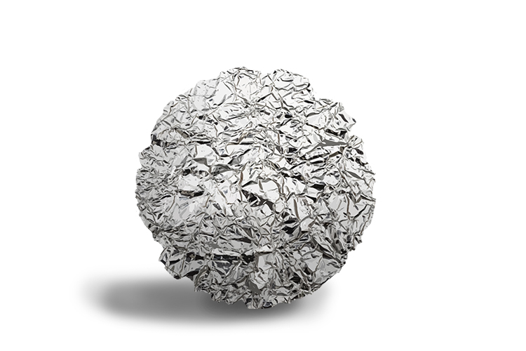 The first step in the process is to form a ball by scrunching up large amounts of aluminium foil.